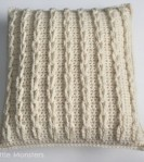 crochet-cable-loop-pillow-260×293